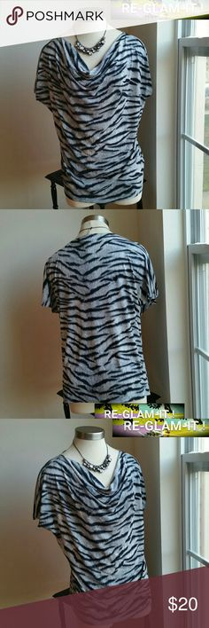 MICHAEL KORS.....BEAUTIFUL TOP ...ADDING INFO SOON ...NORMAL WEAR TO IT.. ...NO FLAWS ...PLEASE READ SIZE TAG LARGE ...BUT FITS MORE LIKE... XL ...DESIGN ZEBRA THROUGHOUT  ...LOOSE FEEL THROUGHOUT  ....STRETCHABLE MTRL...AS SHOWN MICHAEL Michael Kors Tops Blouses