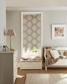 Lift a neutral look without adding colour by mixing different textures and patterns. Made to measure Lomas Taupe Roller blind would work wonderfully. Great for living rooms and dining rooms.