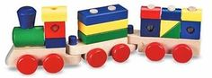 melissa and doug train, he is starting to like putting the blocks on it