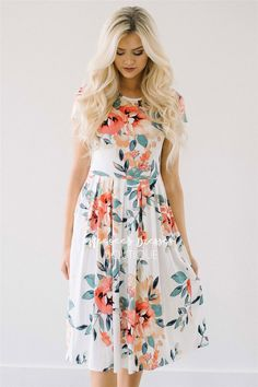 You can never have too many of our cute and comfy floral pocket dress! This ivory dress features a pretty tropical floral print, has a cute pleated waist, short sleeves, and adorable front pockets!