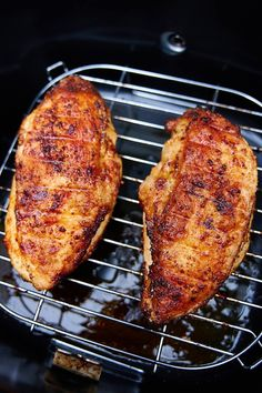 This air fryer chicken breast is crispy on the outside and very juicy inside. It's ridiculously delicious! This chicken breast tastes just like fried, only without an oily mess and added calories. I guarantee you, this is one of the best chicken breasts you can make. They are a must try! Oh, and they only take 30 minutes to cook. A great chicken breast recipe for keto, paleo, weight watchers and low carb diets.| cravingtasty.com