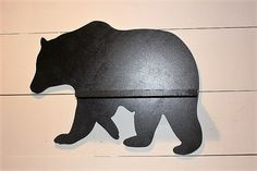 Black bear wall hanging. This bear looks great in any cabin, farmhouse or rustic decor. Painted with a high gloss black paint.  The Bear measures 21L x 16H x 1D. Shelf measures 14L x 3 1/2D. Made from MDF. There are two drill holes under the shelf for hanging.  We also have a bear silhouette - https://www.etsy.com/listing/511917225/black-bear-wall-hanging-black-bear?ref=shop_home_active_1