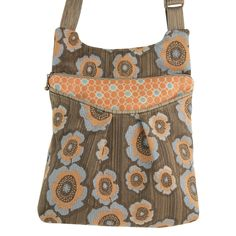 """Maruca Busy Body handbag in Apron Blue.  The sling with a boho vibe. Soft adjustable custom strap. Interior with small pocket. Open exterior pocket for quick access. 9"""" x 9.5"""" x 2"""" Strap drop length: 12"""" - 24"""" Web strap width: 1"""" Handmade in Boulder, CO. Shop The Handbag Store in store at 253 Main St, Hill City SD or online at www.shopthehandbagstore.com."""