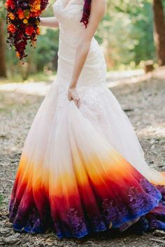 Dip dyed wedding dress. Would be great to hide dirt around the bottom edges, and looks amazing with the boquet. Beautiful!