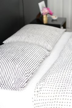 Schoolhouse Electric bedding via Simply Grove. Striped black, white and grey linen sheets.