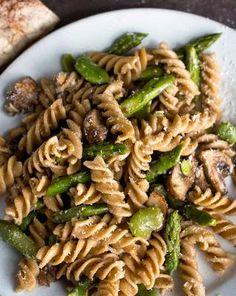 Whole-Grain Pasta With Mushrooms, Asparagus and Favas. Without the Favas for me!