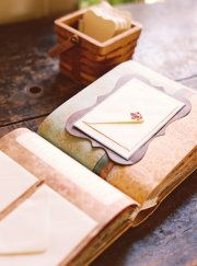 Guest Book DIY - Buy photo book and tear out pages. Put in pages with envelopes on and charms. Have Guests write you notes and stick it on an envelope.