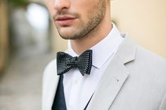 Groom in grey suit and a black bow tie.  Visit our website: www.mylemariage.com  #LeMariage #Wedding #Magazine #Indonesia
