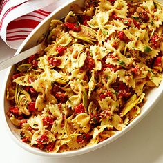 Farfalle with Artichokes, Peppers, and Almonds Ground almonds take the place of pasta's usual parmesan, making this a good vegan choice.