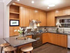 Flat panel cabinets.   Inspired Examples of Quartz Kitchen Countertops | HGTV