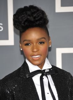 Image 3: Janelle Monae is a prominent female figure in the Hip-Hop world. She presents herself as a conservative yet powerful and classy woman. Monae breaks most of the stereotypes we see in Hip-Hop, promoting the value of women and throwing away the objectified view that has been so prevalent.