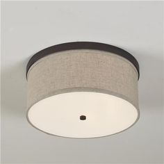 "Bronze  Matte Nickel  Polished Nickel  Springfield Linen Shade Ceiling Light (3 finishes)  Create a clean look on your ceiling with a linen drum shade ceiling light. Sleek metal band housing holds a fine linen drum shade and an acrylic diffuser for soft light.  3x40 watts (medium base socket).  (7.25""Hx15.75""W)    Product SKU: FM10005 BZ  Price:  $145.00  Quantity"