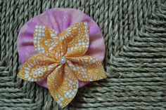 White and Orange floral fabric petal flower with pearl accent set on pink butterfly ruffle (with shimmer) - hair accessories - flowers