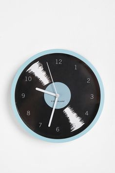 Oddly, I have a small record album clock I got in Camden Town last time I was in the UK... :) This one would match my room, though! @Urban Outfitters $16.00