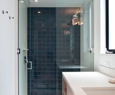 Minimalist opal | Heath Ceramics  A single wall tiled in G21 Opal Pacific (variation 5) 4x4 Classic Field squares is a nice accent in a minimal bathroom.  Photo by Mariko Reed Design by Shawback Design