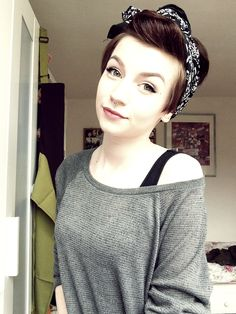 Cute updo, love the sweater, hair scarf adorable, and tiny septum piercing