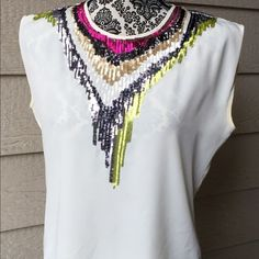 Gorgeous Multicolored Sequined Top Gorgeous cream blouse with multicolored sequined design! Size small. Olive & Oak. Olive & Oak Tops Blouses