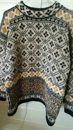 Dale 10010    I knit this sweater in camel and black....just beautiful.   The picture doesn't do it justice.