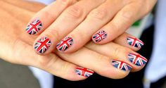 Britain's Union flag is painted onto the fingernails of archer Alison Williamson at the London 2012 Olympic Village.