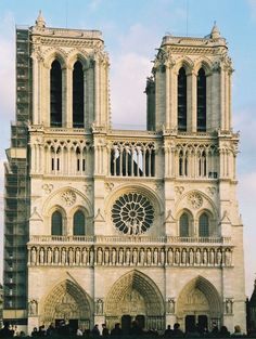 """Notre Dame Cathedral~Paris, France (full name: Cathédrale Notre-Dame de Paris, """"Our Lady of Paris"""") was begun in 1163 and mostly completed by 1250. It is an incredible example of French Gothic architecture, sculpture and stained glass."""