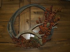 This is a rope wreath with a deer horn. Too cute