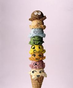 a picture of a giant colorful ice cream cone which I added faces to