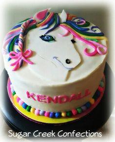Lisa Frank inspired cake . Rainbow horse cake