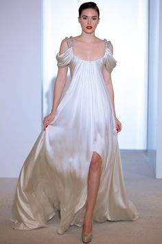Art Deco inspired wedding gown with draped sleeves from Marc Bouwer.