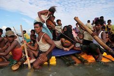 Teknaf, Bangladesh. Rohingya Muslims fleeing Myanmar cross the Naf river on an improvised raft