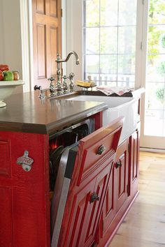 I LUUURVE the color of these cabinets and countertop.  I can see this with upper cabinets to match the door in the background or cream with dark distressing.