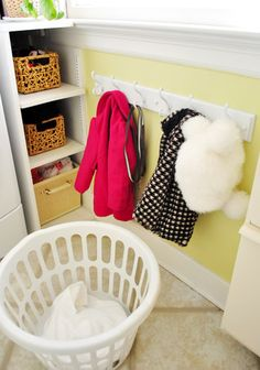 Kid's height coat rack. LOVE this idea! - My little girl always throws hers on the floor because she can't reach the hangers...this would be so nice to have