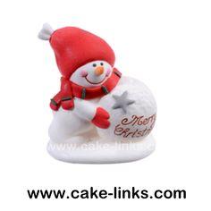 Sugar Snowman pushing a Snowball