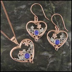 A stunning pendant and earring set in 14K Rose and White Gold set with beautiful Tanzanite.