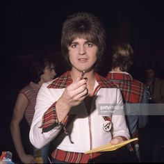 Eric Faulkner of pop group the Bay City Rollers poses signing autographs in May 1976 in Copenhagen, Denmark. Get premium, high resolution news photos at Getty Images Bay City Rollers, Star Tv Series, Les Mckeown, Stuart Woods, Special Olympics, Old Music, Those Were The Days, Music Photo, Teenage Dream