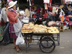 Bolivian street vendor selling bread, photo by: PJFurlong06, used under Creative Commons License(By 2.0)