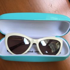"Kate Spade Cat Eye Sunglasses and Case These are a gorgeous pair of Kate Spade cat eye sunglasses. They are an eggshell white frame, and an amazing statement piece. I wore these once--perfect condition. They will come with the bright blue Kate Spade case shown in the pictures that says ""wink wink"" on the inside. Beyond cute. Make me an offer! kate spade Accessories Sunglasses"