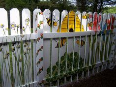 Painted Fence...Gracie and Gavin said I should paint  the bees!
