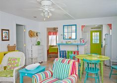 Views of the spacious, open living and dining area. Bright, colorful and fun! This area includes a bar with extra seating; fun place to sit and have a snack!