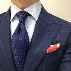 Blue Windowpane suit with orange pocket square.