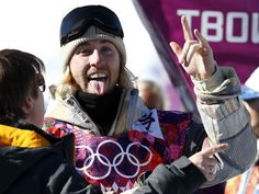 Sage Kotsenburg celebrates winning gold in men's slopestyle.Hm mm..is he dating Miley Cyrus?