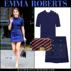 Emma Roberts in navy top, navy gold button mini skirt and yellow pumps