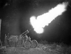 "Shot of 75mm ""Bofors"" anti-aircraft gun in the night"