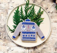 Create your very own Star Wars R2-D2 ugly Christmas sweater cookies with this fun and easy tutorial.