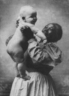 Slave holds baby. So many white babies, a lot of important white men, some of them presidents! raised by black women in bondage!