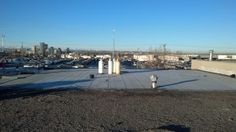 Flat roof replacement with a SBS torch-on onto an industral building in Calgary. The initial assembly was a tar and gravel roof. Flat Roof Replacement, Bragg Creek, Red Deer, June 19, Roof Repair, Calgary, Deer