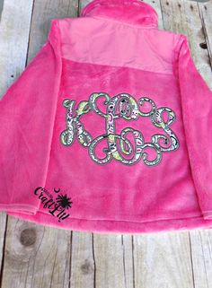 Large Appliqued Monogram on the back of a child's jacket. Done by Carolina Craft It!