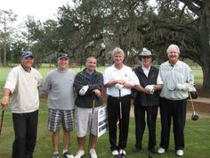Don't let smiles fool you. This was serious golf! Do you know these Ocala businessmen?