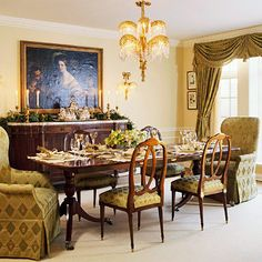 Hospitable Dining Room      Old South hospitality reigns in this dining room, which is bedecked with local greenery. Overhead, an ormolu chandelier with crystal palm fronds sheds light on pineapple-print fabric used on chairs and draperies.