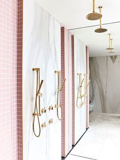 Shower with pink tile and gold hardware