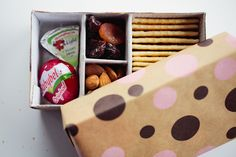 Edible, non-candy favors! Cute polka dotted favor box with dried fruit, cheese, nuts, and crackers.